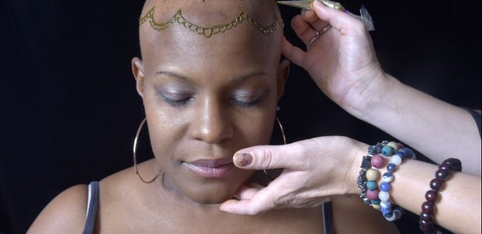 Annapolis-area artist paints over mastectomy scars, bald heads from chemo